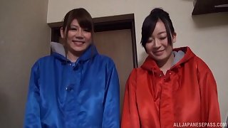 Two naked Japanese ladies enjoy giving a double blowjob to team a few cadger