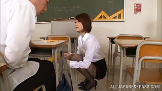Asian teacher in a short skirt fucks one of her students hardcore